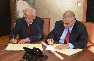 DAÜ ile RDÜ arasında iş birliği protokolü imzalandı