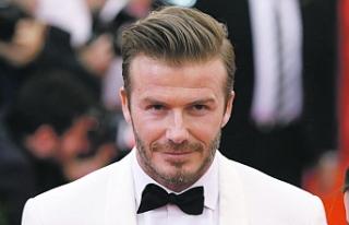 David Beckham, tribünde kızını dudağından öpmesi...
