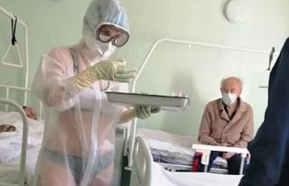 Rusya'da bikini ve şeffaf koruyucu giyerek hastaları...