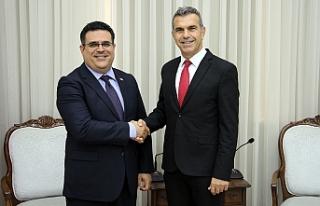 Uluçay, DAÜ Rektörü Hocanın'ı kabul etti