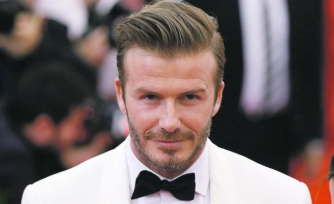 David Beckham, tribünde kızını dudağından öpmesi tepki topladı