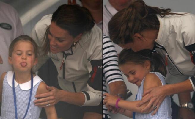 Düşes Kate Middleton'ın kızı 4 yaşındaki Prenses Charlotte, kalabalığa dil çıkardı